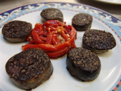 Fried black pudding with roasted peppers